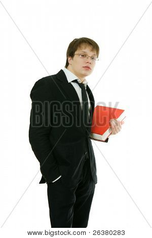 One young good-looking man, wearing eyeglasses and lounge suit is holding a red big book in his hand.