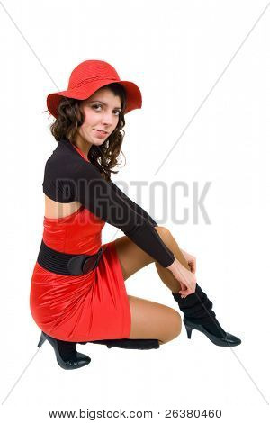 photo of a young nice lady sitting and dressed in black and red clothes