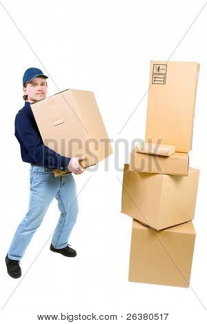 young man carrying a box to the pile of boxes