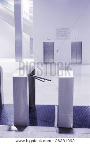 Turnstiles at entrance of modern building