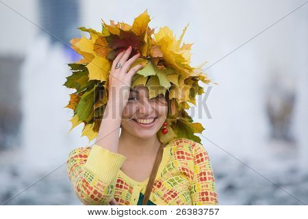 Portrait of young homely woman at autumn