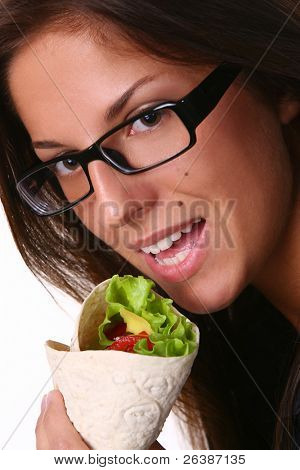 a beautyful woman eating fresh tortilla