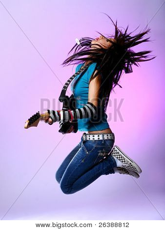 young beautiful girl jump with guitar