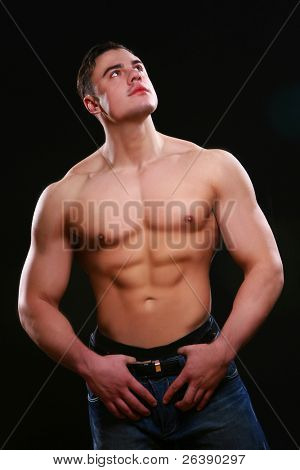 young muscular man on black