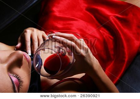 young and sexy woman with red wine