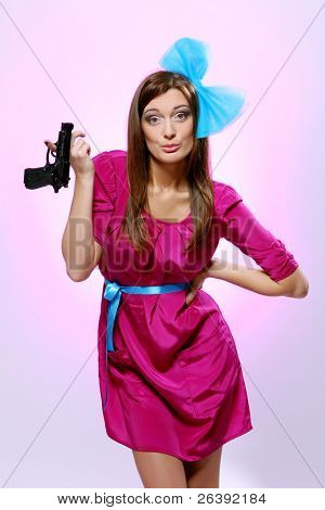 Attractive and sexy spy woman with pistol on white background