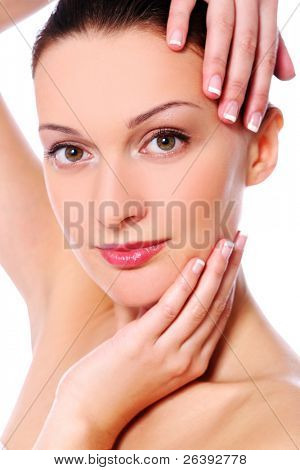 Young and beautiful happy woman relaxing in spa and posing on camera
