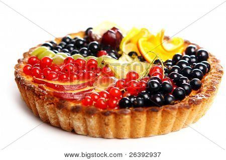 Cake with currant berries and citrus fruits isolated on white background