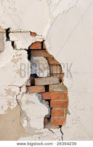 crumbling wall with revealed brick work