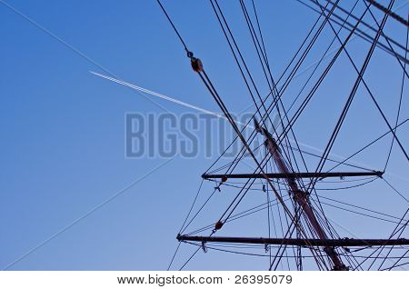 Ship Mast With Airplane Trace On Background