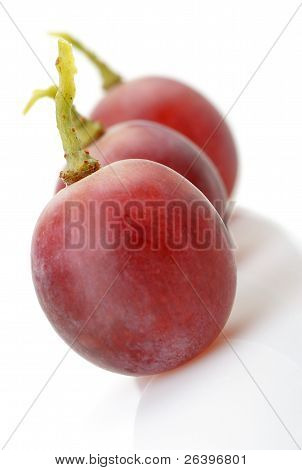 Three Berries Of Red Grapes Abreast