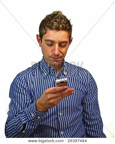 Attractive Young Man Texting On Cell Phone