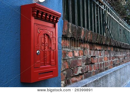 Post box on brick wall