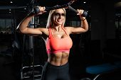 Beautiful Woman Doing Heavy Weight Exercise For Back poster