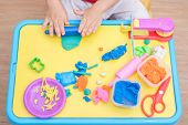 Top View Of Little Asian 2 Years Old Toddler Baby Boy Child Having Fun Playing Colorful Modeling Cla poster