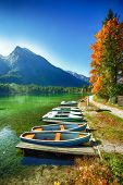Fantastic Autumn Day At Hintersee Lake. Few Boats On The Lake With Turquoise Water Of Hintersee Lake poster