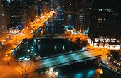 Chicago River With Boats And Traffic In Downtown Chicago At Night poster