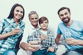 Smiling Family Drinking Water In Glasses At Home. Father And Son. Smiling People. Parenthood Concept poster