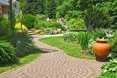 A stone walkway meandering through a garden.