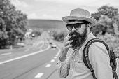 Smoking Habit. Smoking Cigarette Before Long Journey. Man With Beard And Mustache In Straw Hat Smoki poster