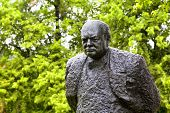 A  bronze statue of Winston Churchill, weighing 1.5 tons and standing ten feet high, is found in Hal