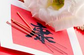 Needles for acupuncturist shown on Chinese health sign. poster