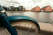 Cityscape With River, Old Buildings And Parked Bicycle In Copenhagen, Denmark. Danish Capital With C poster