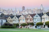 Twilight Over The Painted Ladies Of San Francisco. Iconic Victorian Houses And San Francisco Skyline poster