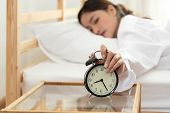 Asian Young Beauty Woman Turning Off Alarm Clock In Morning Late Without Looking Clock And Lazy To W poster