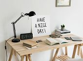 Minimal style workspace with a phrase Have a nice day poster