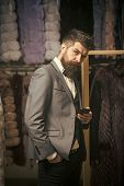 Macho With Stylish Appearance With Fur In Fashion Store. Man With Beard And Mustache At Fur Coat. Gu poster