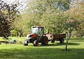 Tractor And Barrow For Working In The Garden. Garden Transport. Wheelbarrow To Work In The Garden. W poster
