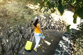 Back View Of Traveler Tourist Woman In Yellow Summer Casual Clothes Hat With Suitcase, City Map Walk poster