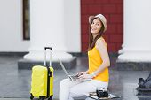 Cheerful Traveler Tourist Woman In Casual Clothes Hat With Suitcase Sit Using Work On Laptop Pc Comp poster