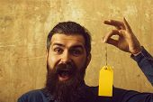 Man With Beard On Happy Face. Guy Hold Shopping Tag. Sale And Shopping. Black Friday In Shop. Busine poster