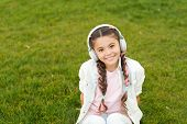 Girl With Headphones Nature Background. Positive Influence Of Music. Child Girl Enjoying Music Moder poster