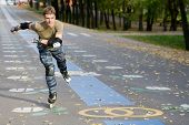 stock photo of inline skating  - Roller skating at autumnal park - JPG