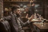 Businessman With Long Beard In Cigar Club. Confident Bar Customer Speak In Cafe. Date Or Business Me poster