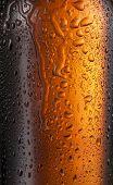 Misted glass of beer bottle. Close up shot. poster
