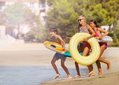 Happy Teens Spending Summertime On The Beach poster