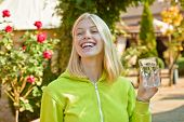 Young Woman Drinking Water. Beauty Girl Drinking Water From Glass On Flover Background. Face Portrai poster