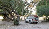 Offroad 4x4 Vehicle With Tent In The Roof Ready For Camping In The Desert poster