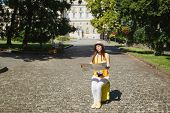 Indifferent Traveler Tourist Woman In Yellow Clothes, Hat Sitting On Suitcase Looking On City Map Se poster