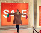 Consumerism, Shopping, Lifestyle Concept Woman In Shopping. Happy Woman With Shopping Bags Enjoying  poster