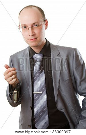 Handsome Young Business Man In A Stylish Suit  And Car Keys Isolated On White.more Of This Series On