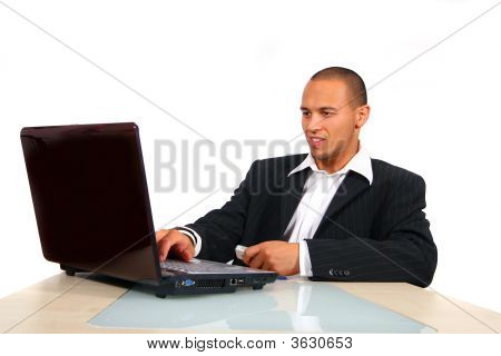 Young Business Man Working On His Laptop