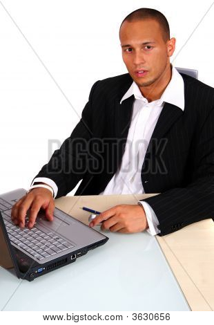 Young Businessman In Front Of Laptop