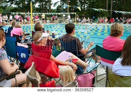 Parents And Spectators Watch Neighborhood Swim Meet