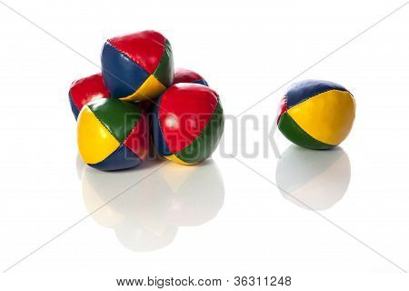 Set of six juggling balls with reflection.