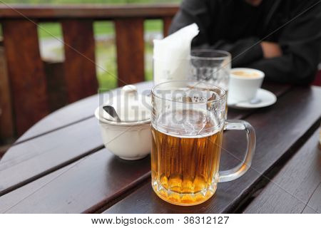 beer mug on a table in a city restaurant outdoor